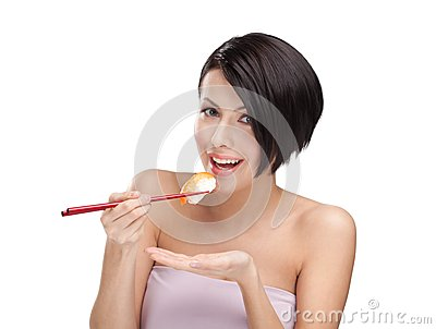 Young woman holding sushi with a chopsticks