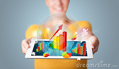 Young woman holding tablet with colorful graphs and diagrams