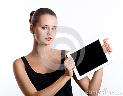 Young woman holding a tablet computer over white background