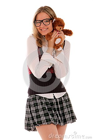 Young woman holding teddy bear