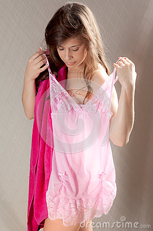 Young Woman Holding Up Nightie to Self