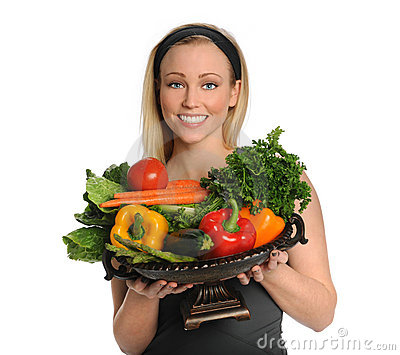 Young Woman Holding Vegetable Bowl