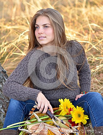 Young woman holding vegetables basket outdoor