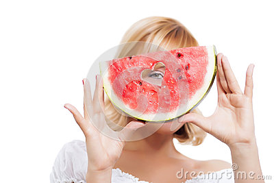 Young woman holding watermelon