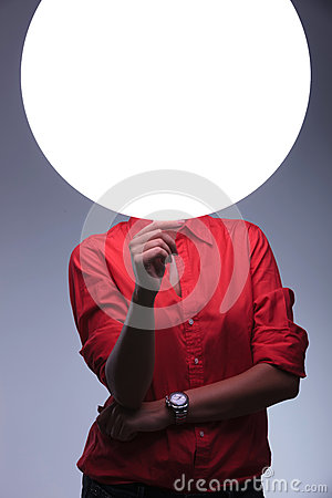 Young woman holds a blank circle in front of face