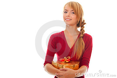 Young woman holds gold gift box as heart