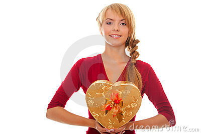 Young woman holds in hands gift box as heart