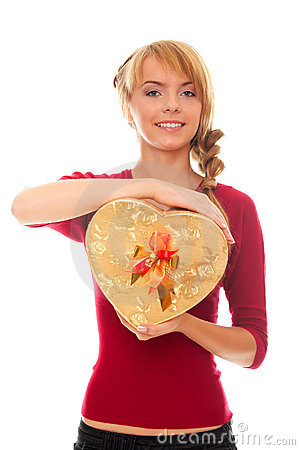 Young woman holds in hands gold gift box as heart