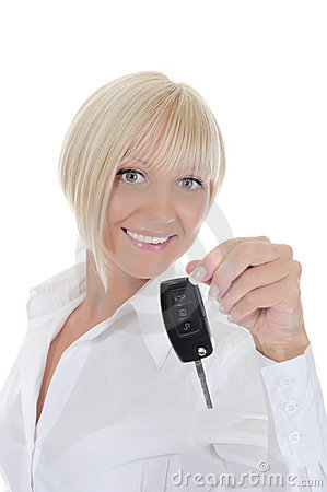 Young woman holds the key to the car