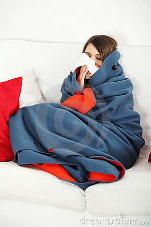 Young woman at home having flu.
