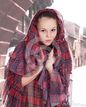 Young woman in the hood in the old style