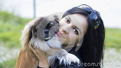 Young woman hugging her dog friend