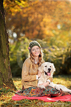 Young woman hugging a labrador retriever dog