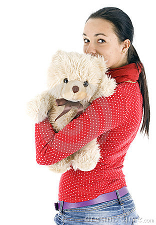 Young woman hugging Teddy bear