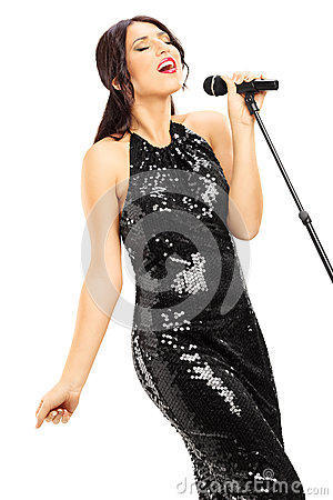 Free Young Woman In Black Dress Singing Stock Photos - 35273543