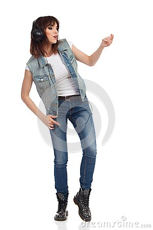 Free Young Woman In Headphones Is Singing And Playing Air Guitar Royalty Free Stock Photos - 99712998