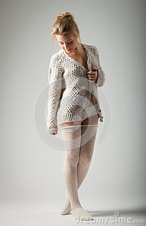 Free Young Woman In Knitted Jumper  On Gray Background Royalty Free Stock Photos - 27780848