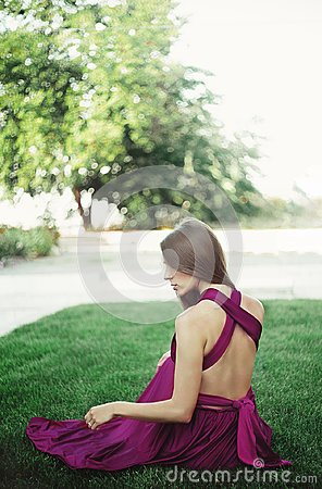 Free Young Woman In Long Dress Sitteng On A Grass. Royalty Free Stock Images - 111854529