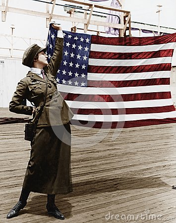 Free Young Woman In Military Uniform Holding Up An American Flag Royalty Free Stock Photography - 52019247