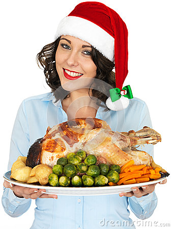 Free Young Woman In Santa Hat Holding Roast Turkey And Vegetables Royalty Free Stock Photo - 51297285