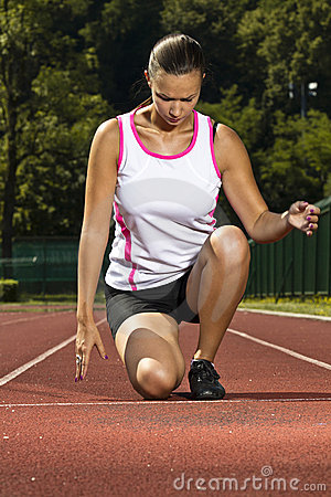 Free Young Woman In Sprinting Position Stock Photography - 20260622