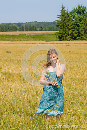 Free Young Woman In Summertime Field Stock Photography - 75858352