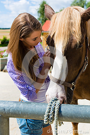 Free Young Woman In The Stable With Horse At Sunshine Stock Photos - 28557783
