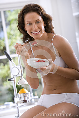 Free Young Woman In Underwear Eating Breakfast, Smiling, Portrait Stock Photos - 41710883