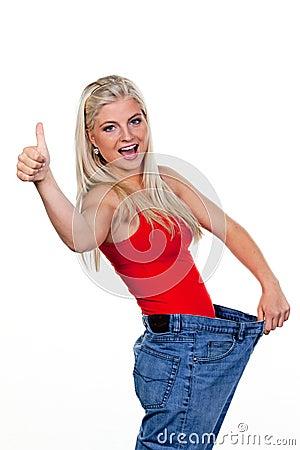Young Woman Indicating Weight Loss Success