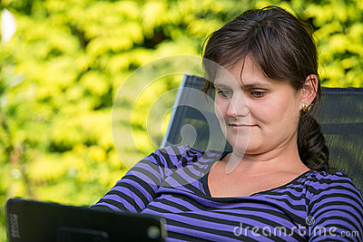 Young woman with iPad (tablet computer)