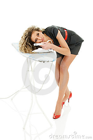 Young woman ironing curly hair