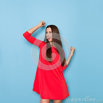 Free Young Woman Is Laughing With Arms Raised Stock Photo - 108435230