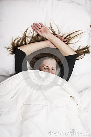 Free Young Woman Is Lying In Her Bed With Closed Eyes, Smiling Under Her Blanket After A Restful Sleep. Stock Photography - 103480412