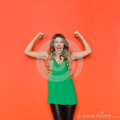 Free Young Woman Is Shouting With Arms Outstretched Stock Photography - 111304372