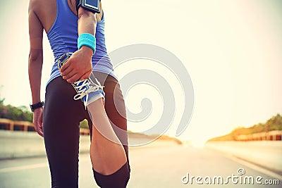 Asian Woman Stretching Legs Stock Photo