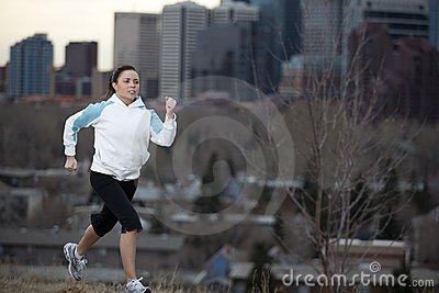 Young woman jogging in city.