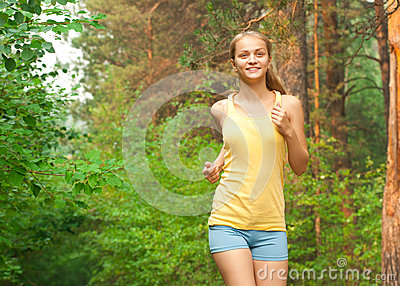 Young woman jogging in park