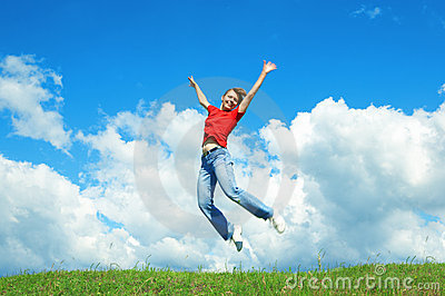 Young woman jump on green grass