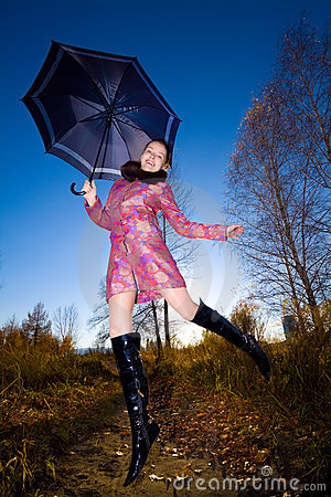 Young woman jump with umbrella in hand