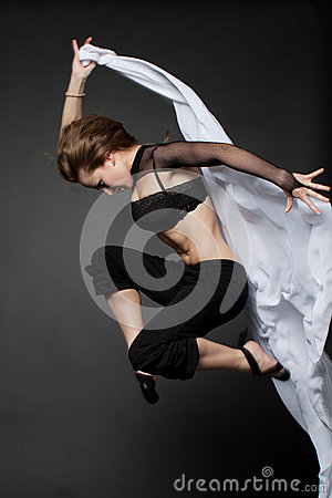 Young woman jumping from a developing tissue.