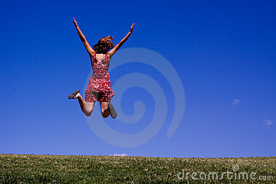 Young woman jumping for joy!