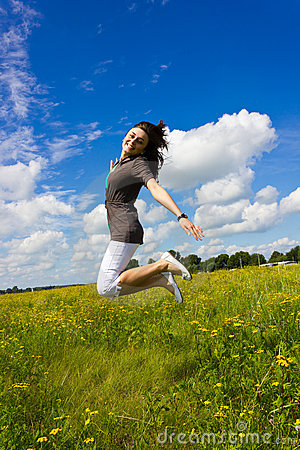 Young woman jumping for joy in the air