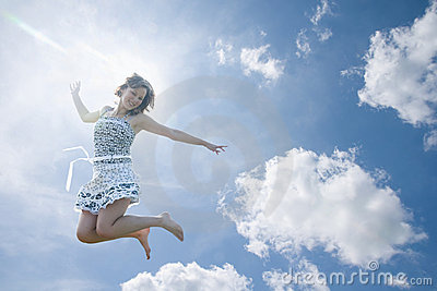 Young woman jumping in sky