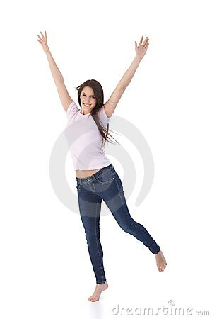 Young woman jumping up happily