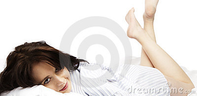 Young woman just awakening in bed