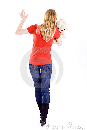 Young woman keeping Teddy bear