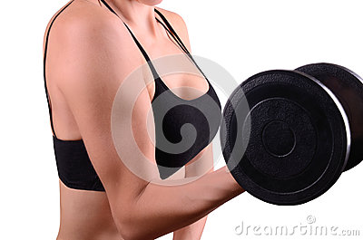 Young woman keeps the dumbbell arm
