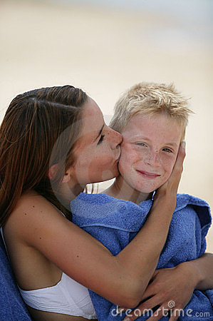 Young woman kissing boy