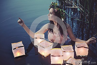 Young woman with lanterns