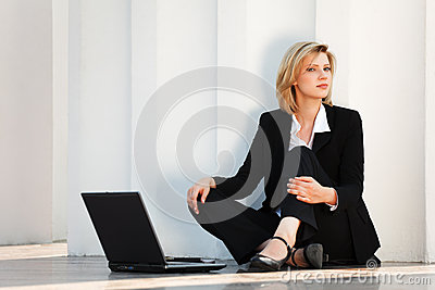 Young fashion business woman with laptop